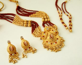 Indian Necklace and Earrings in Matt Gold and Dark Red Beads -Sparkly, Dangly Jewellery