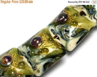 ON SALE 30% off Four Emerald Treasure Pillow Beads - Handmade Lampwork Beads 10505214