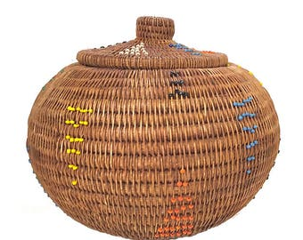 Lombok basket single rod coiled rattan basket . Indonesia ratan ball basket with lid  . decorated with seed beads  . triangle pattern