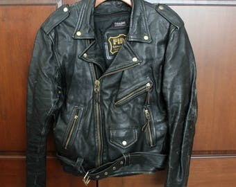 Black Leather Motorcycle Jacket by First Size 40, Vintage Belt Bottom, Adjustable Tie Side Panel, Zip Out Liner
