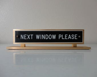 VINTAGE 'next window please' SIGN