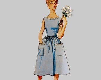 1964 dress sewing pattern Simplicity 5460 Wraps in the back Sleeveless dress Patch pockets Scooped neck dress Size 16 Bust 36 inches