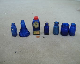 7 assorted small vintage cobalt blue glass medicine bottles and jars