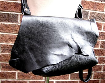 Black leather fanny pack , small leather convertible messenger, folds over envelope bag, leather clutch and wristlet, leather wrist bag