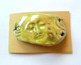 Bracelet Link Finding with Face in Green Glazed Raku Fired Clay