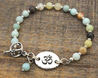 Om symbol bracelet, light blue amazonite beads, semiprecious stone, 8 inches long
