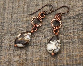 "Black and white teardrop earrings, Niobium French hooks, brioche agate beads, hammered look rings, 1 3/4"" long"