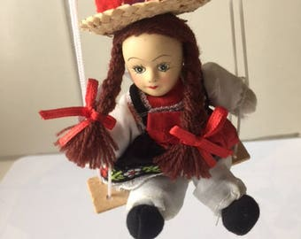 Vintage traditional folk costume girl doll for hanging - Germany Black Forest Europe - Black white - girl sitting in swing