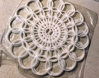 Vintage plastic doilies-New in package-tupperwear