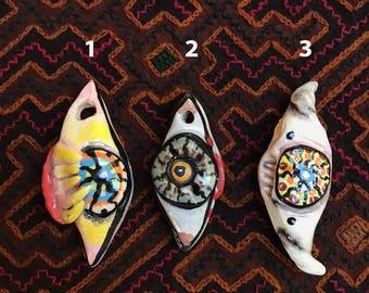 Evil Eye MyndMonster ceramic pendant. Modern talisman for self help and distraction therapy.