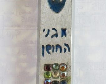 "A vintage mezuzah case made by ""Hen-holon"" on the 1970's"