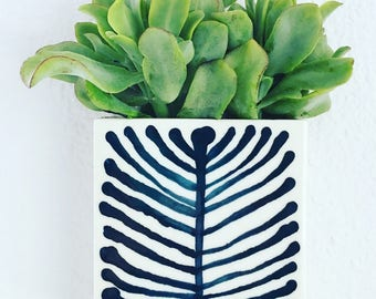 medium porcelain planter / wall vase hand drawn original pine cone pattern in blue.