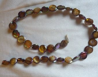 Beads, Dark Brown Mother of Pearl 10mm Flat Round Coin. Sold per 15 inch strand. There are 35 beads on the strand.