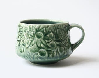 Cup with Australian Flannel Flower design - Deep green stoneware ceramic cup