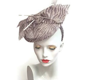 Taupe zebra print sinamay saucer fascinator hatinator with feather detail headband fixing ideal wedding races