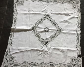 A pretty, antique, hand made lace tablecloth.