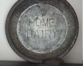 Vintage metal small embossed Home Dairy pie plate
