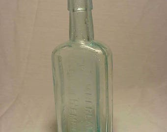 c1890s Chamberlain's Cough Remedy Des Moines, Iowa , Aqua Cork Top Blown Glass Medicine bottle