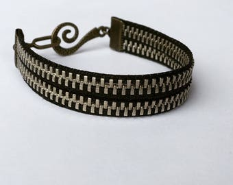 bracelet in a bronze and black zipper with toggle clasp. bangle style boho jewelry.