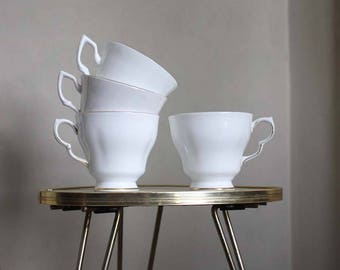 Four assorted vintage teacups. White gold porcelain tea cups. UK made Regina, Colclough Fine bone china