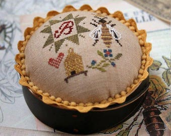 Pre-order 2018 Nashville Market HEARTSTRING SAMPLERY Queen Bee Pincushion counted cross stitch patterns at thecottageneedle.com