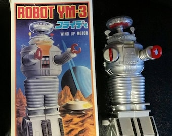 Masudaya Ym-3 Antique Tin Wind Up walking  Robot Japan 1985 in original BOX. Excellent quality Rare Vintage Toy. Shipped worldwide from USa.