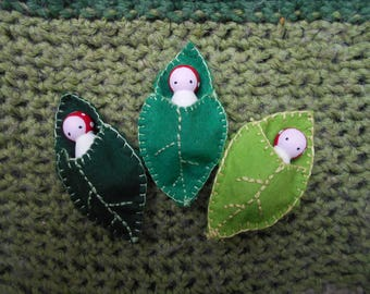 Toadstool leaf babies, wooden peg dolls in wool mix  felt leaf bed