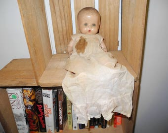 Shabby, distressed bisque baby doll.  Orphaned Closing eyes lonely doll.   Creepy Shabby Doll. Bisque head, hands and feet.