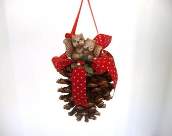 Ornament, pine cone ornament, decorated pine cone with ceramic love squirrels