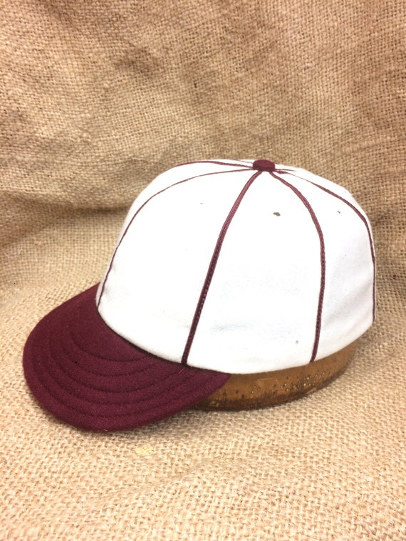 Hand crafted 8 panel Baseball cap. Soft white wool flannel cap with maroon  1920's visor, maroon soutach trim, fitted to any size.