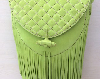 Fringed crossbody shoulder bag in lime green nubuck leather with quilted flap and fully lined in teal suede. Handmade and handstitched.