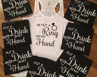 He put a ring on my hand tank, put a drink in my hand tank! Bridal party tanks, Bridal party shirts.