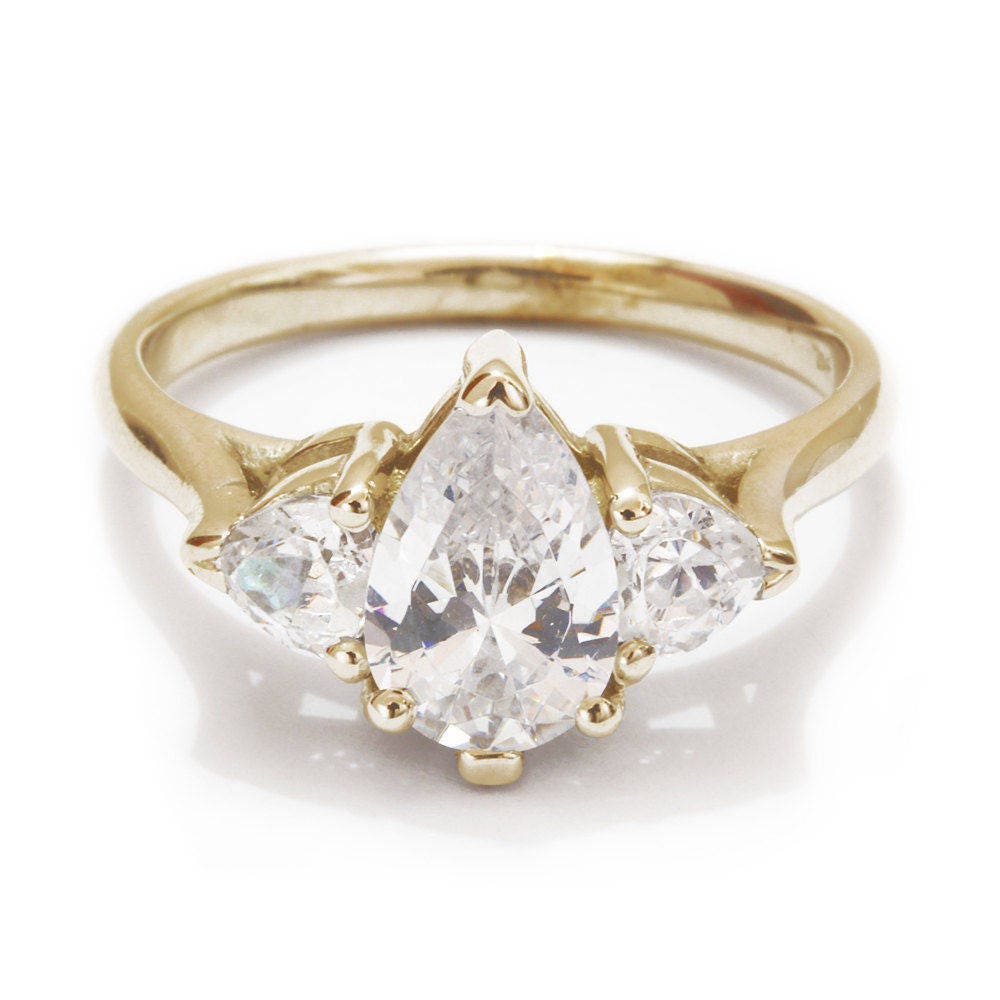 unique three engagement ring pear shaped