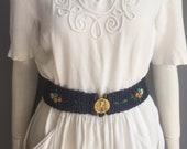 1930s belt, blue raffia with Discobolus buckle