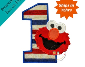 Patriotic first birthday/holiday iron-on patch embroidered in cobalt blue thread with red puppet face embroidered in red thread with details