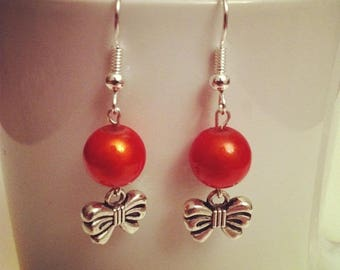 Bows and orange beads earrings