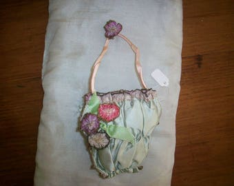 Wonderful sachet 1920s antique with silk ribbons edged in metal