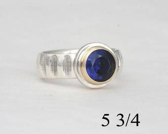 Saphire ring, size 5 3/4 ring with an 8 mm manmade blue sapphire, #132.