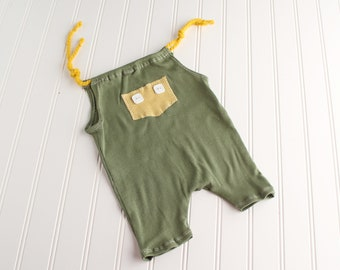 Wayne Down Under - Sitter 6-9m romper shortalls in a dusty olive green with mustard yellow pocket and white buttons (RTS)