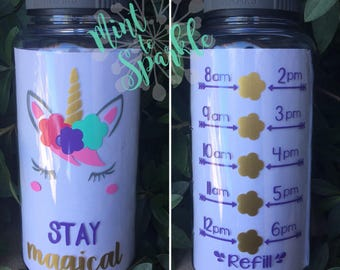 Stay Magical unicorn face motivational water bottle with hourly time tracker