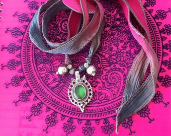 Bracelet/Necklace with multicolored silk tie and tribal pendants