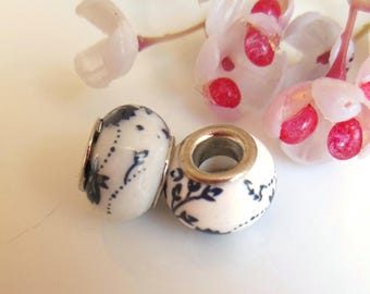 set of 2 Blue ceramic beads white and flowers