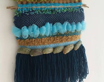 Stormy beaches and sandy seascapes are the inspiration for this weaving