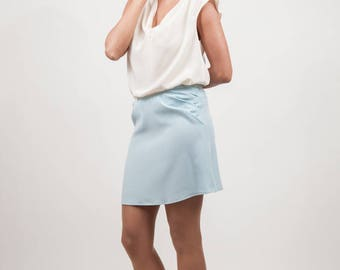 sky blue skirt with pleats at side