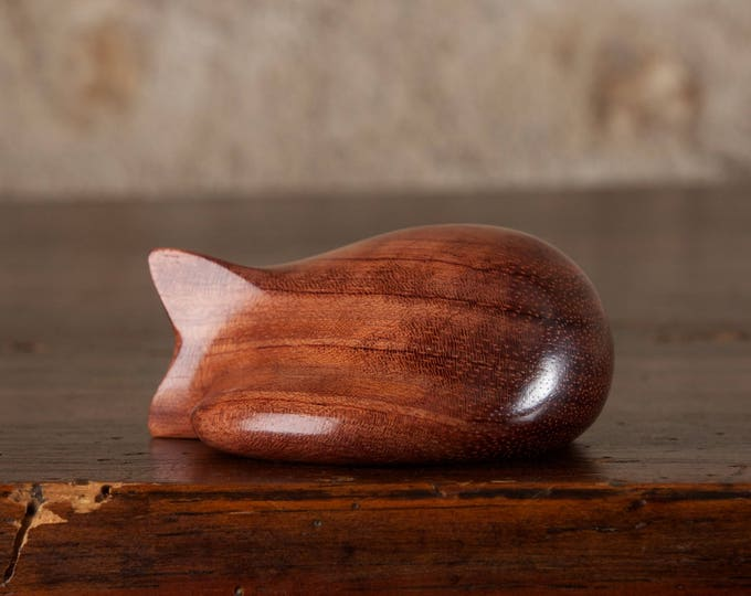 Featured listing image: Curled Cat Sculpture, Wooden Sleeping Cat Figurine Hand Carved From Butterfly Tree Mopane Wood by Perry Lancaster, Tactile Pebble