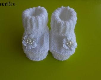 white baby's booties