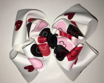 Hearts galore on this adorable stacked hair bow