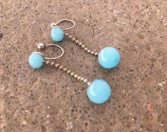 CLIPS U earrings with light blue glass beads