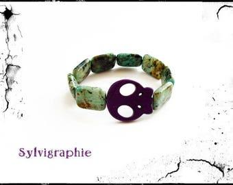Bracelet and purple skull beads