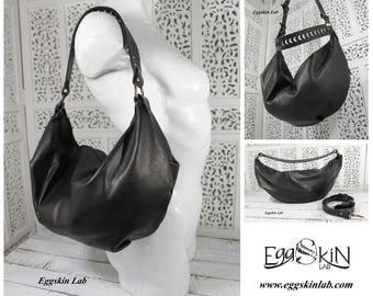 Lenora, borsa in pelle e cuoio italiani di ottima qualità, si può indossare monospalla con il manico fisso intagliato a mano o a tracolla.